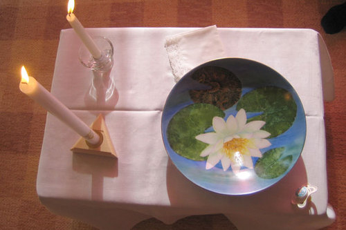 Table with two candles and waterbowl waiting for Babtism.